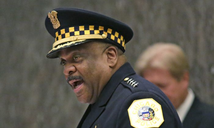 Eddie Johnson, left, speaks after being sworn in as the new Chicago police superintendent in Chicago, on April 13, 2016. (M. Spencer Green, AP Photo/File)