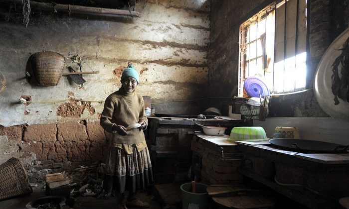 A rural woman cooks with a biogas stove in the outskirts of Kunming, in the China's southwestern Yunnan province on Nov. 4, 2009. (Liu Jin/AFP/Getty Images)