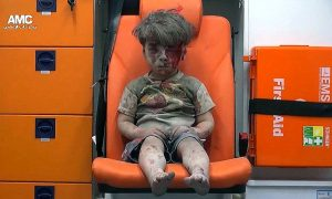 Haunting Image of Syrian Boy Rescued From Aleppo Airstrike Rubble