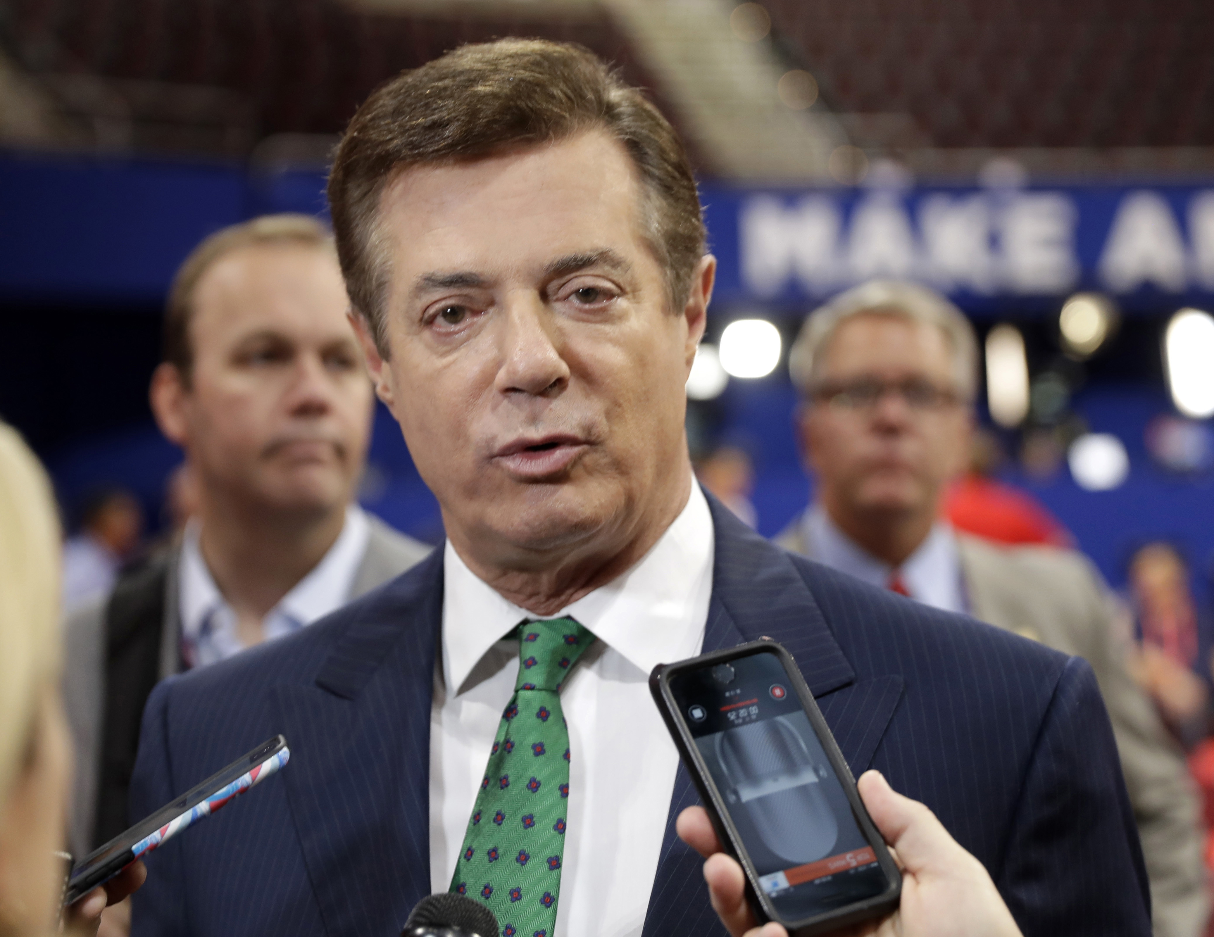 Paul Manafort talks to reporters on the floor of the Republican National Convention at Quicken Loans Arena in Cleveland on  July 17, 2016. (AP Photo/Matt Rourke)