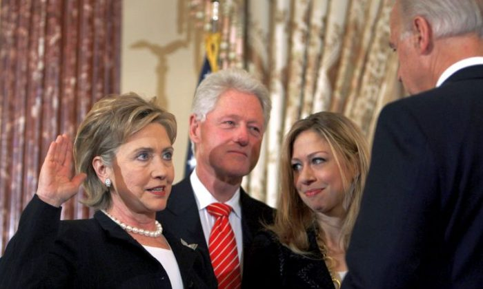 In this Feb. 2, 2009 file photo, Vice President Joe Biden, right, swears in Secretary of State Hillary Rodham Clinton in a ceremonial swearing-in at the State Department in Washington, accompanied by her husband, former President Bill Clinton, and their daughter, Chelsea. This time, it's Bill Clinton's turn to be the adoring spouse, rapt and smiling when the cameras cut away from the candidate in the spotlight. He'll be the He in the VIP box watching as a She accepts the presidential nomination at the Democratic convention on Thursday, July 28, 2016. It's one small step in the role reversal that Americans will need to get used to if Hillary Clinton wins in November. (AP Photo/Lawrence Jackson, File)