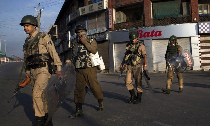 Indian paramilitary soldiers patrol during curfew in Srinagar, Indian-controlled Kashmir, on Aug. 19, 2016. (AP Photo/Dar Yasin)