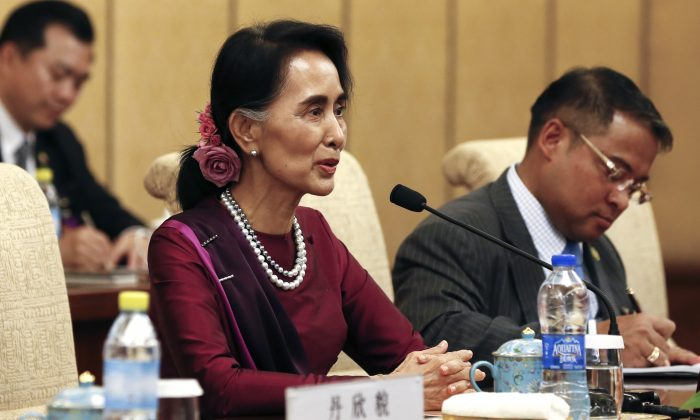 Burma's State Counselor Aung San Suu Kyi hold a talk with Chinese President Xi Jinping, at the Diaoyutai State Guesthouse in Beijing, China, on Aug. 19, 2016. (Rolex Dela Pena/Pool Photo via AP)