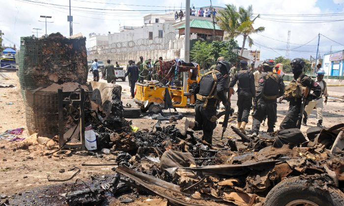 Somali security investigate the scene of a suicide attack in Mogadishu on July 31, 2016. (Mohamed Abdiwahab/AFP/Getty Images)