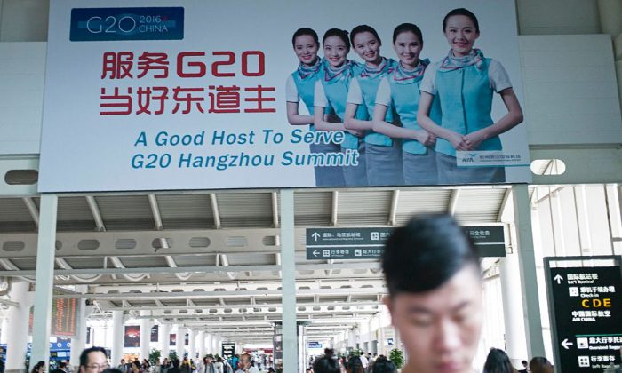 A billboard for the upcoming G20 Hangzhou Summit is seen at the airport in Hangzhou on May 21, 2016. (Fred Dufour/AFP/Getty Images)