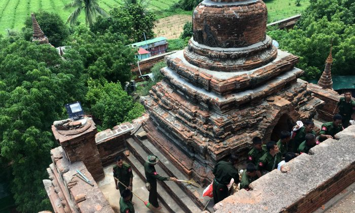 Military personnel clear debris at a temple that was damaged by a strong earthquake in Bagan, Myanmar, Thursday, Aug. 25, 2016. (AP Photo/Min Kyi Thein)