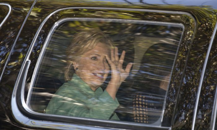 Democratic presidential candidate Hillary Clinton waves from her motorcade vehicle as she arrives for a fundraiser at the home of Justin Timberlake and Jessica Biel in Los Angeles on Aug. 23. (AP Photo/Carolyn Kaster)