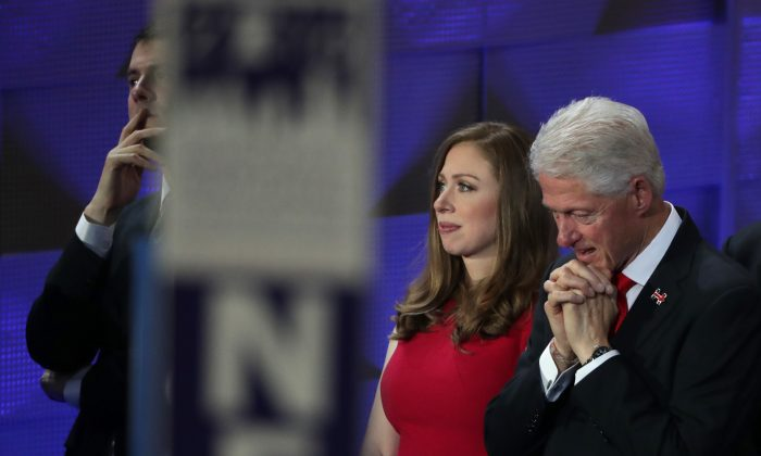 Chelsea Clinton and former US President Bill Clinton seen at the end of the fourth day of the Democratic National Convention at the Wells Fargo Center, July 28, 2016 in Philadelphia, Pennsylvania. (Alex Wong/Getty Images)