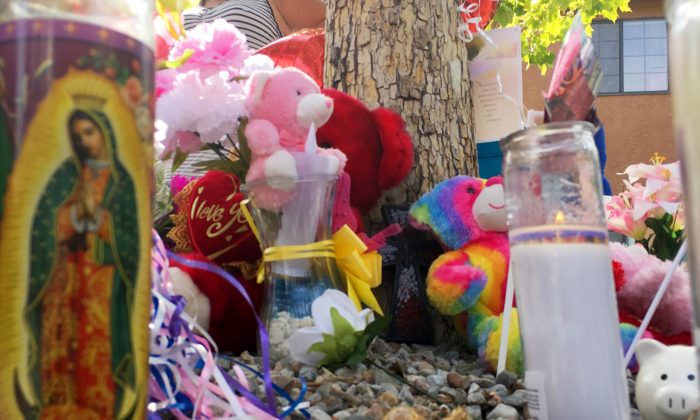 A memorial for a 10-year-old girl who police said was sexually assaulted, strangled then dismembered is seen at an Albuquerque, N.M., apartment building Thursday, Aug. 25, 2016. On the day the girl was going to celebrate her 10th birthday, she was found dead Wednesday in her family's apartment by Albuquerque police, her dismembered remains lying under a burning blanket. The girl's mother, 35-year-old Michelle Martens, her 31-year-old boyfriend, Fabian Gonzales, and his 31-year-old cousin, Jessica Kelley, are facing charges. (AP Photo/Russell Contreras)