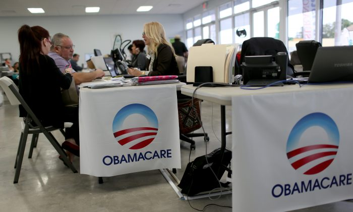 MIAMI, FL - FEBRUARY 05:  Aymara Marchante (L) and Wiktor Garcia sit with Maria Elena Santa Coloma, an insurance advisor with UniVista Insurance company, as they sign up for the Affordable Care Act, also known as Obamacare, before the February 15th deadline on February 5, 2015 in Miami, Florida. Numbers released by the government show that the Miami-Fort Lauderdale-West Palm Beach metropolitan area has signed up 637,514 consumers so far since open enrollment began on Nov. 15, which is more than twice as many as the next large metropolitan area, Atlanta, Georgia.  (Photo by Joe Raedle/Getty Images)