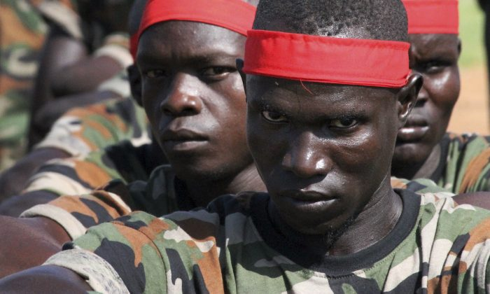 A group of government soldiers wait in line during a military parade celebrating the national army in Juba, South Sudan, on May 16, 2016. (AP Photo/Justin Lynch)