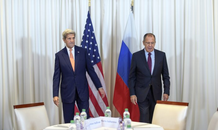 U.S. Secretary of State John Kerry (L) and Russian Foreign Minister Sergei Lavrov (R) walk to their seats prior to a bilateral meeting in Geneva, Switzerland, on Aug. 26, 2016. (Martial Trezzini/Pool Photo via AP)