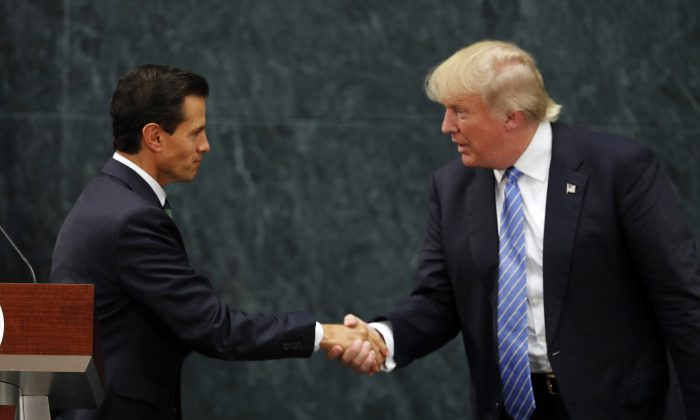 Mexico President Enrique Pena Nieto and Elect-President Donald Trump after a joint statement at Los Pinos, the presidential official residence, in Mexico City, on Aug. 31, 2016. (AP Photo/Dario Lopez-Mills)