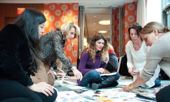 : Colour forecasters Daniella Nicolelli, left, Jane Harrington, Meredith Mullins, Dee Schlotter and Anke Bodack brainstorm with mood boards for the 2017 PPG colour palette for paint. They unanimously picked Violet Verbena, a grayish purple, as their colour of the year.   (PPG Paints via AP)