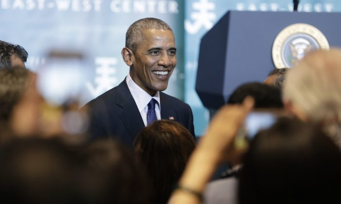 President Barack Obama greets people in the audience after speaking to the 2016 Pacific Islands Conference of Leaders at the East West Center, in Honolulu, Wednesday, Aug. 31, 2016. (AP Photo/Carolyn Kaster)