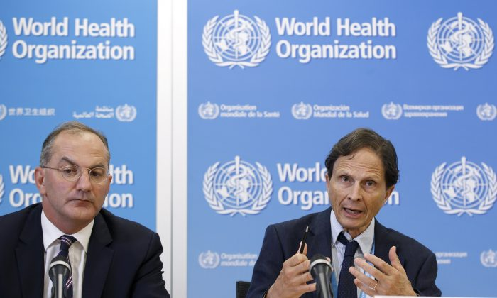 David Heymann, right, Chair of the Emergency Committee on Zika and observed increase in neurological disorders and neonatal malformation, sitting next to Peter Salama, left, Executive Director Outbreaks and Health Emergencies of the World Health Organization, WHO, informs to the media after the 4th meeting of the Zika Virus Infection and Possible Neurological Complications Emergency Committee, at the headquarters of the World Health Organization (WHO) in Geneva, Switzerland, Friday, Sept.  2, 2016. (Salvatore Di Nolfi/Keystone via AP)