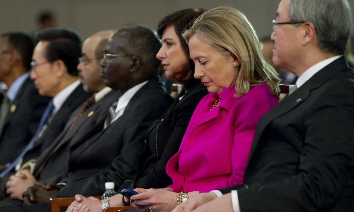 Then Secretary of State Hillary Clinton checks her BlackBerry while attending a forum in Busan, South Korea, on Nov. 30, 2011. (Saul Loeb/AFP/Getty Images)