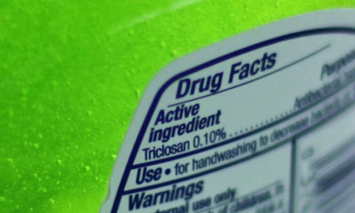 FILE - This Tuesday, April 30, 2013 file photo shows the label of a bottle of antibacterial soap in a kitchen in Chicago. The U.S. government is banning more than a dozen chemicals, including triclosan, long-used in antibacterial soaps and washes, saying manufacturers have failed to show that they are safe and prevent the spread of germs. (AP Photo/Kiichiro Sato)