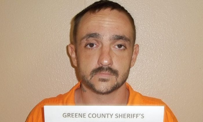 A photo provided by the Greene County Sheriff's Department shows Derrick Dearman, a suspect in the Saturday massacre of five adults in Citronelle Ala. Dearman, of Leakesville, Mississippi, will be charged with six counts of capital murder, Mobile County sheriff's spokeswoman Lori Myles said Sunday, Aug. 21, 2016. (George County Sheriff's Department via AP)