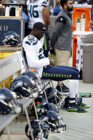 Seattle Seahawks cornerback Jeremy Lane sits as the national anthem plays before a preseason NFL football game against the Oakland Raiders Thursday, Sept. 1, 2016, in Oakland, Calif. (AP Photo/Tony Avelar)