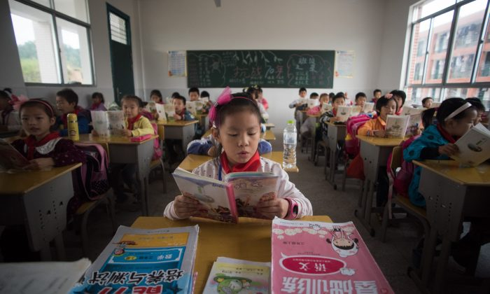 Chinese schoolchildren attended class at the Shiniuzhai Puan Center Primary School in Pingjiang County in China's Hunan Province, on the first day back to school after the national holidays. (Johannes Eisele/AFP/Getty Images)