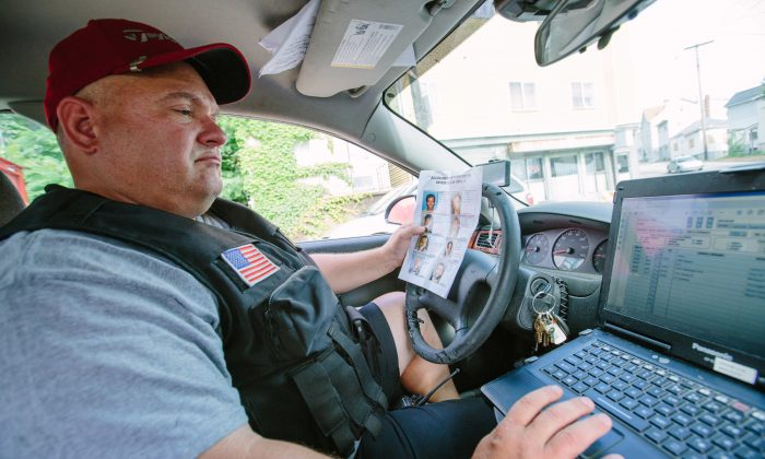 On July 5, 2016, Sgt. Doug Clarke, from the Allegheny County Sheriff's Department, logs locations the deputies visit each day, noting where they found fugitives and where they struck out. A Post-Gazette review of records from some of the country's largest counties found that it often takes officials months to track down violators. (Andrew Rush/Post-Gazette via AP)