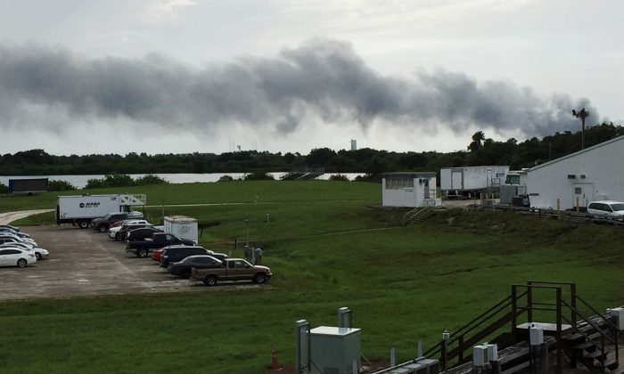 Smoke rises from a SpaceX launch site at Cape Canaveral, Fla., on Sept. 1, 2016. NASA said SpaceX was conducting a test firing of its unmanned rocket when a blast occurred. (AP Photo/Marcia Dunn)