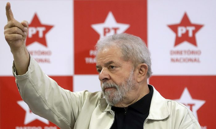 Brazil's former President Luiz Inacio Lula da Silva arrives to meet with the Workers Party National Executive Committee to discuss the political situation after President Dilma Rousseff was removed from office, in Sao Paulo, Brazil, on Sept. 2, 2016. (Andre Penner/AP Photo)