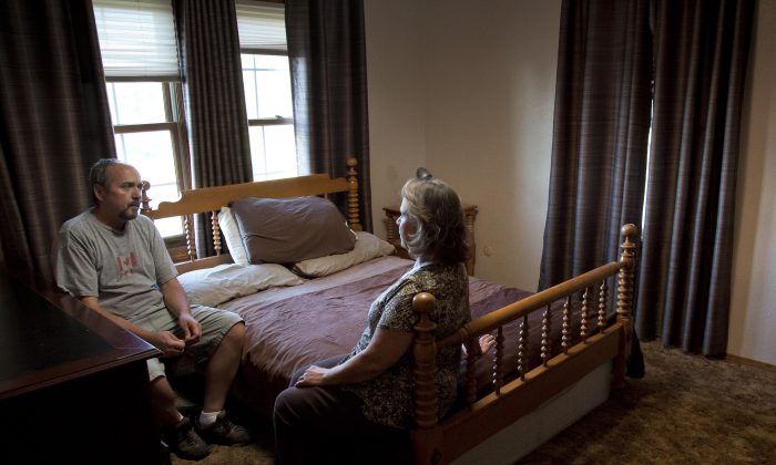 On Aug. 23, 2016, sitting in their son Nigel's bedroom, Mark Youngberg and his wife Sharon recount the events in their Emmett, Idaho home that lead to the 30-year-old's death last spring. The room has gone unchanged since April when Nigel's bouts with schizophrenia and paranoia became critical and he jumped out of a second story window wearing only a robe, light jacket and sneakers. He was confronted by Gem County sheriff's deputies but fled farther into the mountains in the dark of night. His body was found 11 miles away near Montour 16 days later. (Darin Oswald/Idaho Statesman via AP)