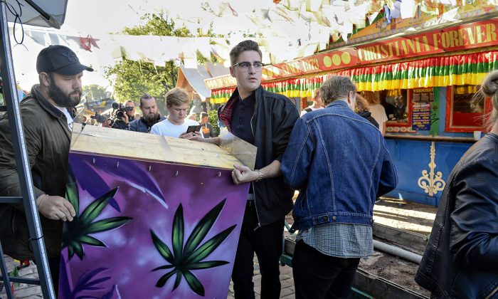 Residents of Christiania remove the illegal hashish stalls in Pusher Street, Copenhagen, on Friday, Sept 2, 2016. (Thomas Borberg/AP via POLFOTO)
