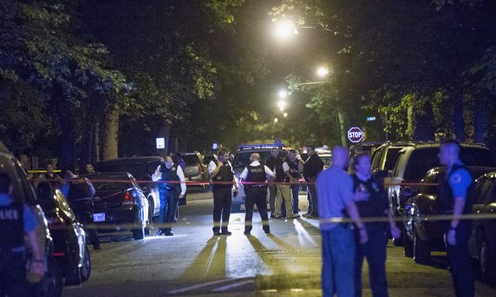 A 15-year-old boy was shot and killed and nine others were shot across Chicago on Aug. 6. (Scott Olson/Getty Images)