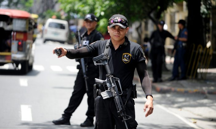 Special Weapons and Tactics (SWAT) personnel patrol the streets of Manila, Philippines, on Sept. 3, 2016, as Davao city and central Manila is placed on high alert following an earlier bomb blast. (Noel Celis/AFP/Getty Images)