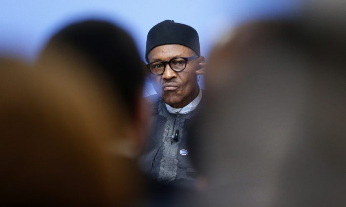 Nigeria President Muhammadu Buhari listens during a panel discussion at the Anti-Corruption Summit in London, England, on May 12, 2016. (AP Photo/Frank Augstein)