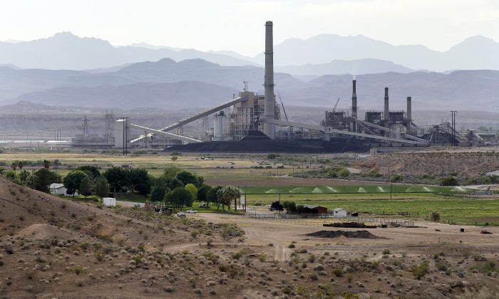 The Reid-Gardner power generating station near a farm on the Moapa Indian Reservation in Moapa, Nev. (AP Photo/Julie Jacobson)