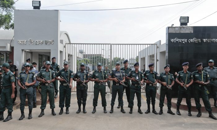 Bangladeshi security personnel stand guard in front of Kashimpur Central Jail where Mir Quasem Ali, a senior leader of the main Islamist party Jamaat-e-Islami, is being held, in Gazipur, on the outskirts of Dhaka, Bangladesh, on Sept. 3, 2016. (AP Photo)