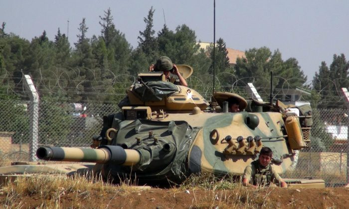 A Turkish army tank stationed near the Syrian border, in Suruc, Turkey on Sept. 3, 2016. (AP Photo)