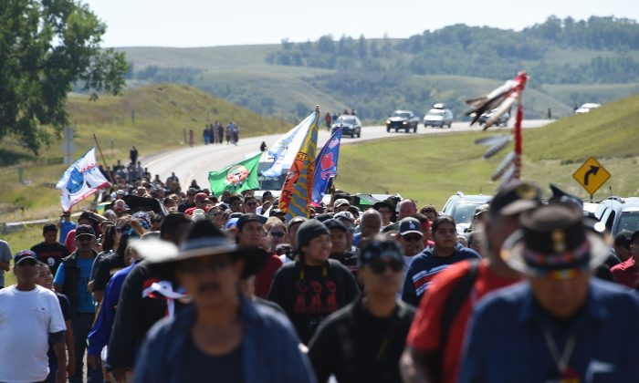 Protestors march to a construction site for the Dakota Access Pipeline to express their opposition to the pipeline, at an encampment where hundreds of people have gathered to join the Standing Rock Sioux Tribe's to protest against the construction of the new oil pipeline, near Cannon Ball, North Dakota, on Sept. 3, 2016. (Robyn Beck/AFP/Getty Images)