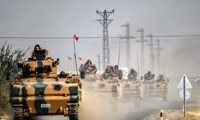 Turkish Army tanks drive to the Syrian-Turkish border town of Jarabulus on Aug. 25, 2016. (Bulent Kilic/AFP/Getty Images)