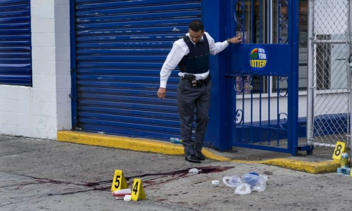 Crime scene investigators with the New York Police Department work at the scene where multiple people were killed and others injured in a shooting during J'ouvert festivities in the Brooklyn borough of New York on Monday, Sept. 5, 2016. (AP Photo/Craig Ruttle)