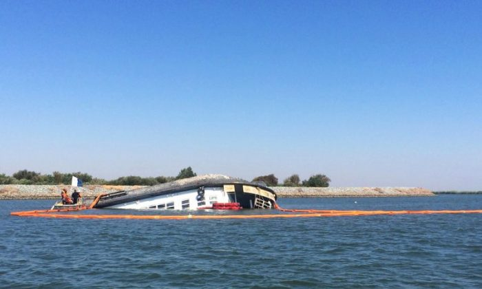 In this Monday, Sept. 5, 2016 photo, responders from Coast Guard Sector San Francisco monitor response efforts at the scene of the capsized vessel Spirit of Sacramento near Bethel Island, Calif. The riverboat sitting capsized in the Sacramento-San Joaquin River Delta is spurring worries about pollution. (Petty Officer 2nd Class Cory Mendenhall/U.S. Coast Guard via AP)