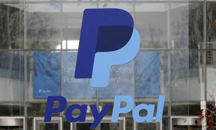 Signage outside PayPal headquarters in San Jose, Calif. After a tax ruling against Apple on Aug. 30, 2016. (AP Photo/Jeff Chiu, File)