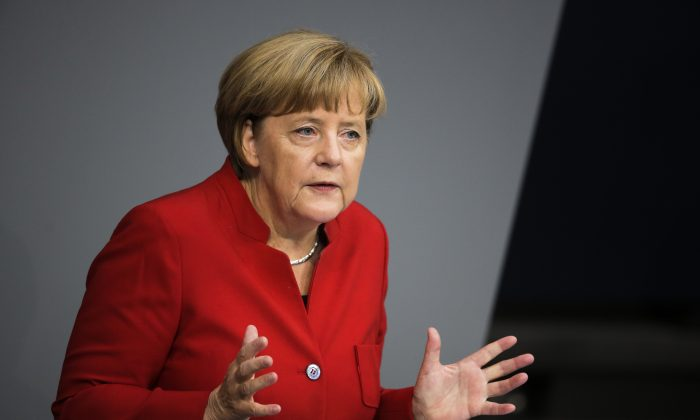 German Chancellor Angela Merkel delivers her speech during the budget 2017 debate at the German parliament Bundestag in Berlin, Wednesday, Sept. 7, 2016. (AP Photo/Markus Schreiber)