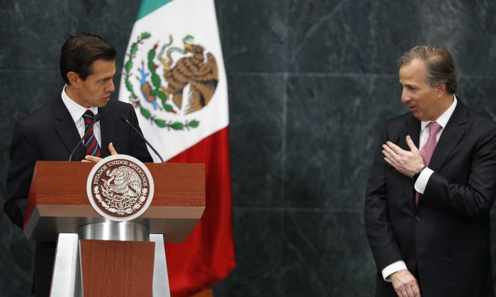 Mexico's President Enrique Pena Nieto, left, compliments newly-named Finance Secretary Jose Antonio Meade, before Meade was sworn-in during a ceremony at Los Pinos presidential residence in Mexico City, Wednesday, Sept. 7, 2016. Meade, the former finance secretary, who had since served as foreign relations secretary, and social development secretary, will return to the Treasury Department to replace Luis Videgaray. Videgaray resigned Wednesday, in a move observers said was linked to the unpopular decision to invite Republican presidential nominee Donald Trump to visit Mexico. (AP Photo/Dario Lopez-Mills)