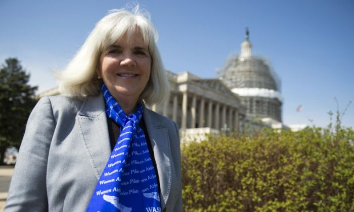 In this March 16, 2016, file photo, Terry Harmon, daughter of WWII veteran WASP (Women Airforce Service Pilots), Elaine Harmon, speaks to reporters after an event with members of congress on the reinstatement of WWII female pilots at Arlington National Cemetery on Capitol Hill in Washington. (AP Photo/Molly Riley, File)