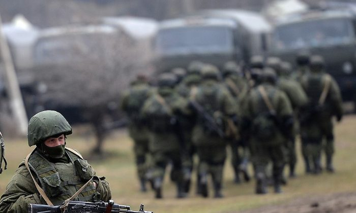 Russian soldiers patrol the area surrounding the Ukrainian military unit in Perevalnoye, outside Simferopol, on March 20, 2014. (FILIPPO MONTEFORTE/AFP/Getty Images)