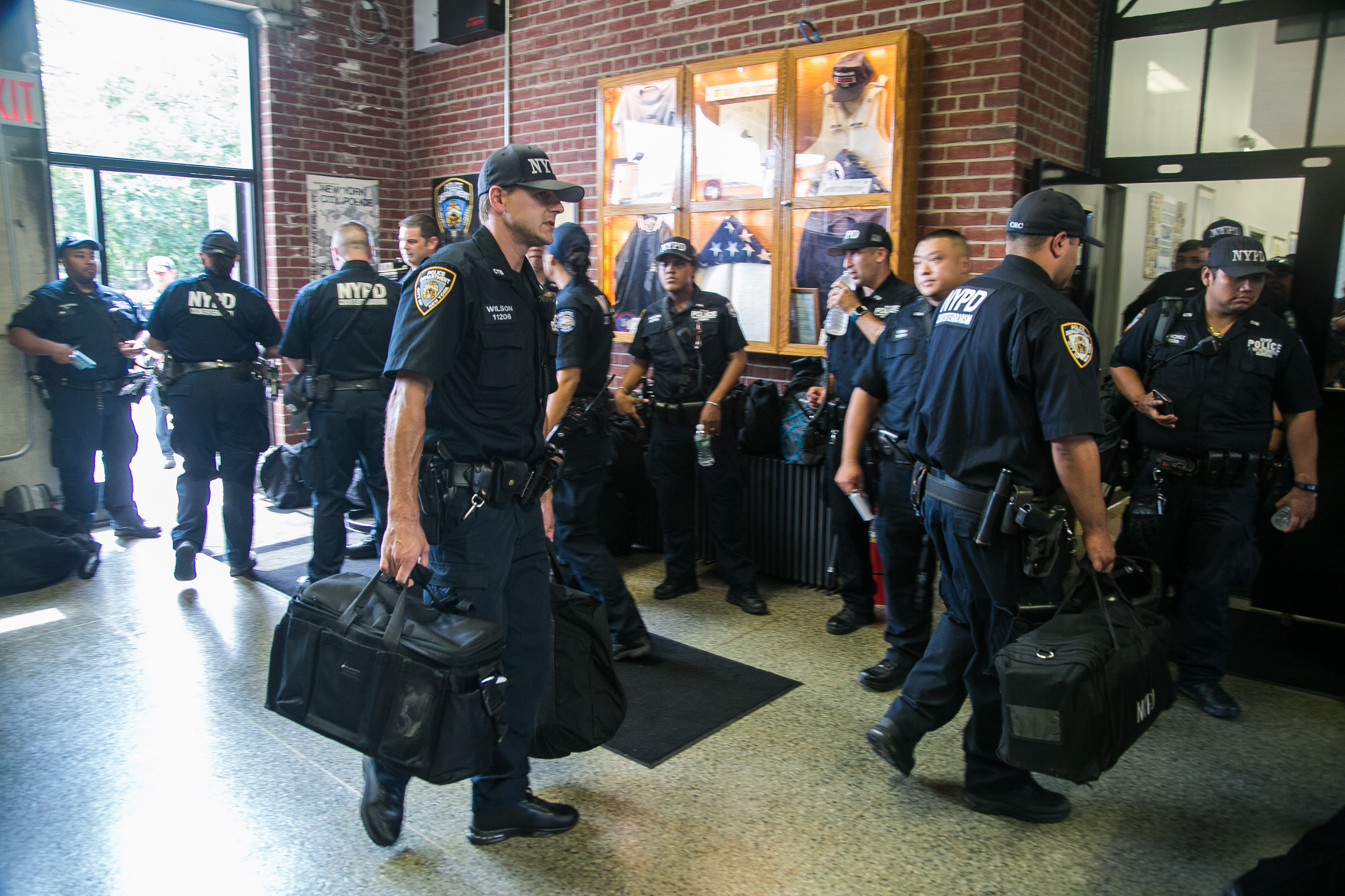 Officers of the NYPD Counterterrorism Bureau return from their shifts, while others prepare to start theirs, at their headquarters on Randall's Island in New York on Aug. 11, 2016. (Benjamin Chasteen/Epoch Times)