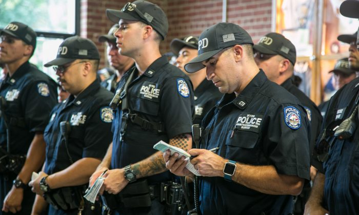 Officers of the NYPD Counterterrorism Bureau receive orders on where they will be patroling, at their headquarters on Randall's Island in New York on Aug. 11, 2016. (Benjamin Chasteen/Epoch Times)
