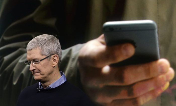 Apple CEO Tim Cook speaks at an event to announce new products at Apple headquarters in Cupertino, Calif., on March 21, 2016. (AP Photo/Marcio Jose Sanchez)