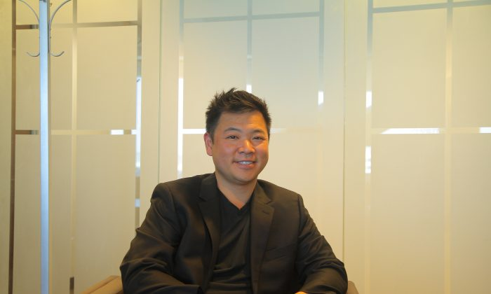 Bob Yau at his office in Redwood City on July 1 (Anton Jiang/Epoch Times)