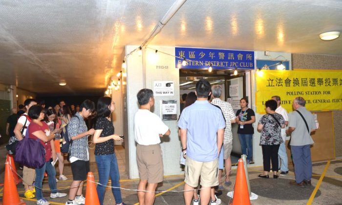 People queued until after midnight at many polling stations including this one at Tai Koo Shing, on Hong Kong Island, to cast their votes in the Hong Kong LegCo election on Sept 4, 2016. (Bill Cox/Epoch Times)